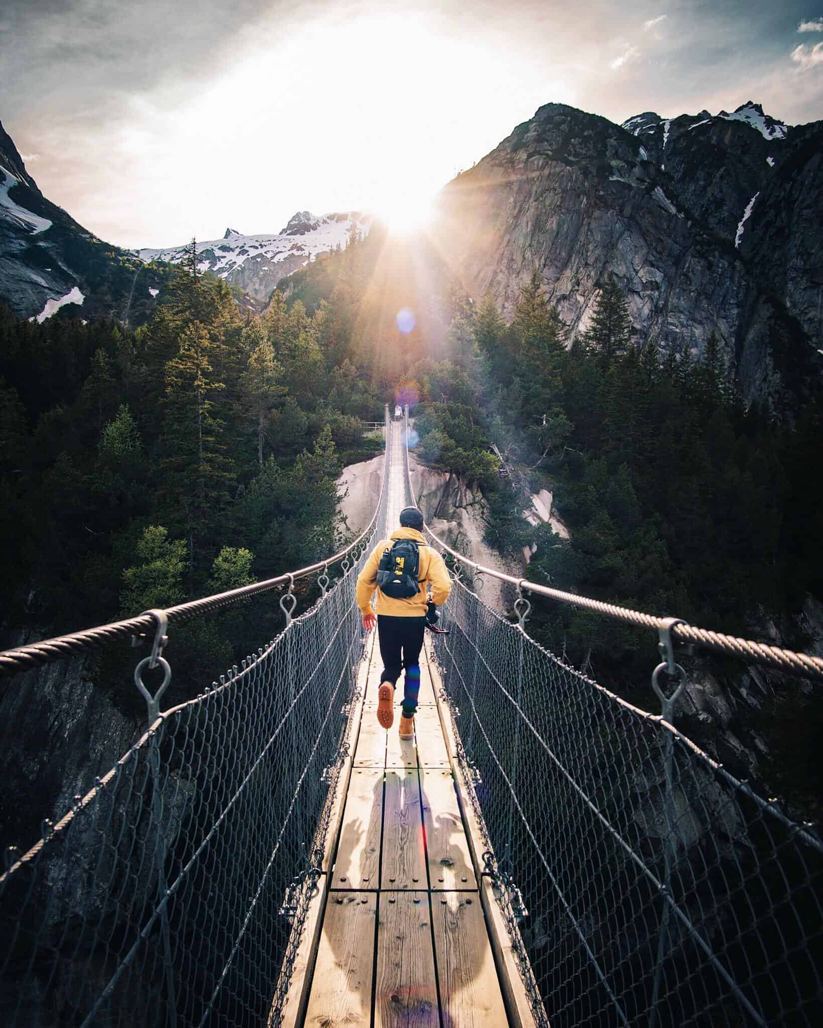 man-running-on-a-bridge-in-the-mountains